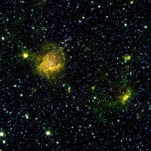A star forming region called BG2107+49 shines from the considerable distance of more than 30,000 light years away in the upper left of this image.