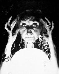 OLD FORTUNE TELLER GAZES INTO CRYSTAL BALL